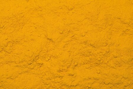 curcuma: Tumeric - curcuma spice texture as background Stock Photo