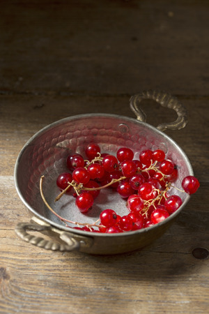 red currant: Red currant in a vintage silver bowl