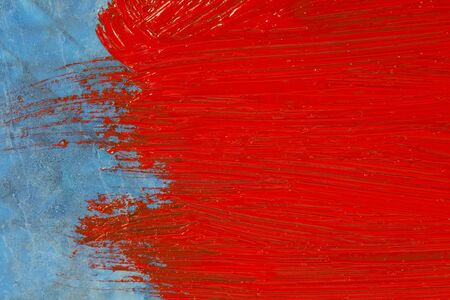 Red and blue painted oil color surface