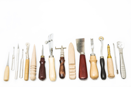 Leather craft tools isolated on white background