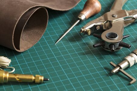 striker: Leather craft tools on a cutting mat Stock Photo