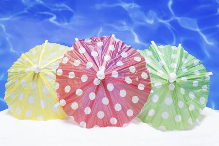 paper umbrella: Summer background with the colorful umbrellas Stock Photo