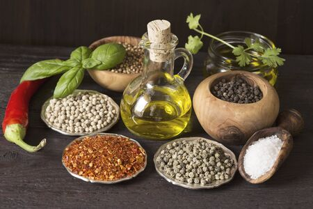 Herbs and spices on wooden background Stock Photo