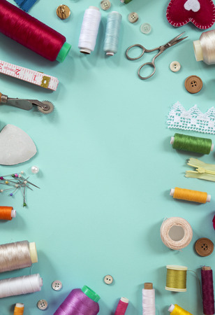 Various sewing items on blue background