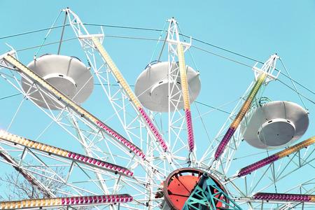 Ferry wheel against blue sky Stock Photo