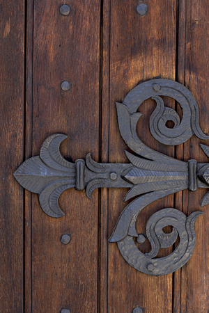 Vintage manacle on massive wooden door