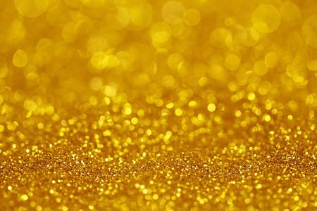 Golden glitter light as background 스톡 콘텐츠