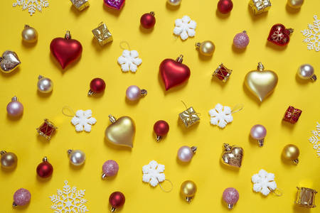 Christmas and New Year ornaments on yellow background