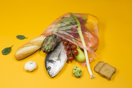 Food ingredients with aurata fish in a plastic bag Banque d'images