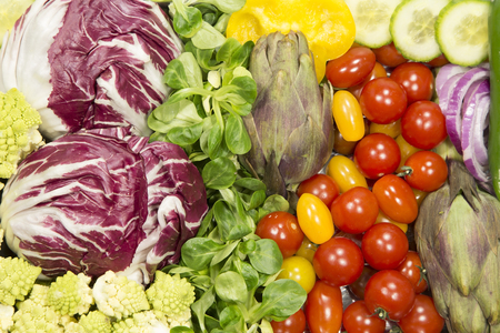 Fresh vegetables on a market close up as background Imagens