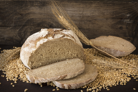 Homemade rye bread on wooden background