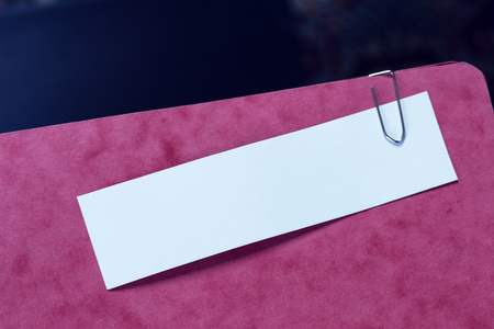 Red folder with a blank note