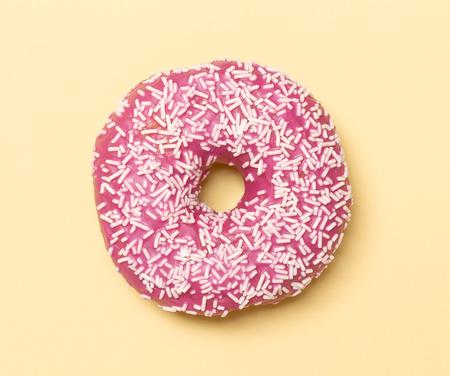 Pink donut with white sugar sprinkles Archivio Fotografico - 123223170