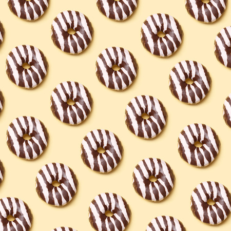 Chocolate donut pattern on yellow background Archivio Fotografico - 123223175