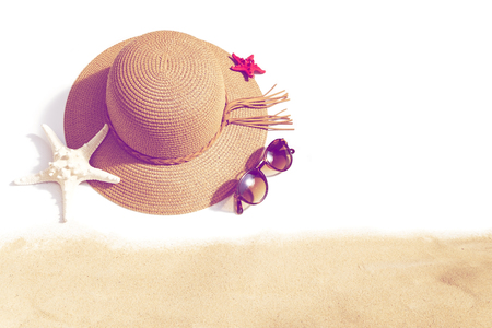Woman's beach accessories on white background