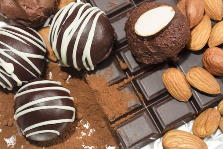 Chocolate truffles with cocoa powder and almonds