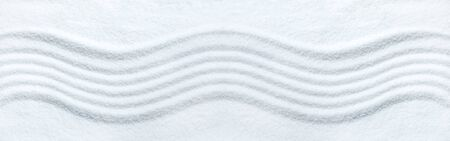 Zen wave pattern in white sand