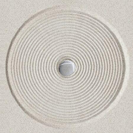 Zen circle pattern on sand background Stock Photo