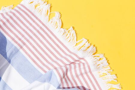 Beach towel on yellow background