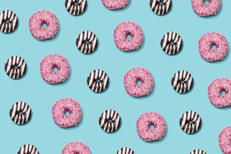 Decorative donuts seamless patterm on blue background
