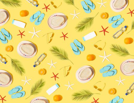 Beach concept - seamless pattern of beach accessories on yellow background