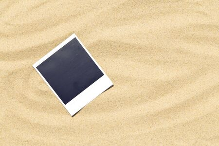 Blank instant image on sand background