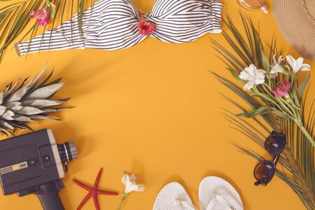 Summer woman`s accessories on yellow background