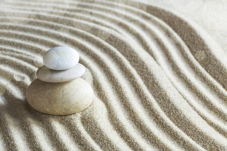 Zen garden with the rocks on sand pattern