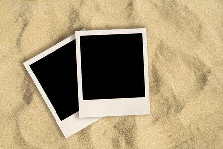 Blank instant images on sand background Reklamní fotografie - 127668535