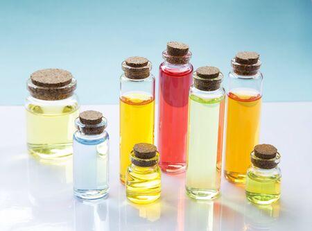Colorful essence oil bottles on white background Reklamní fotografie