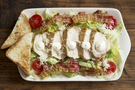 Ceasar salad on a whte plate Stok Fotoğraf