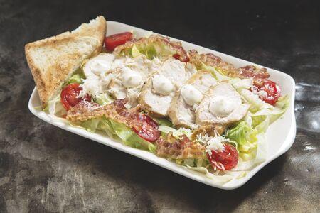 Ceasar salad on a whte plate Reklamní fotografie - 132125182