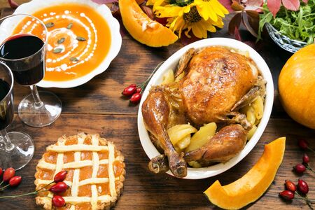 Thanksgiving dinner on white rustic table