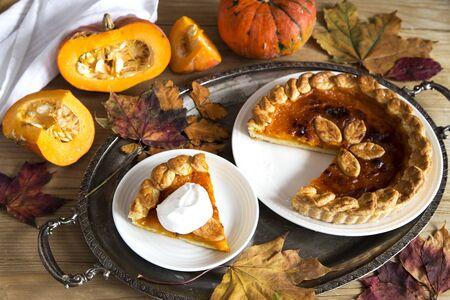 Pumpkin pie with creme on vintage silver trey