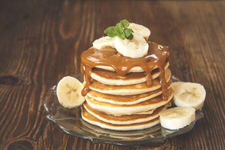 Pancakes with caramel sauce and banana