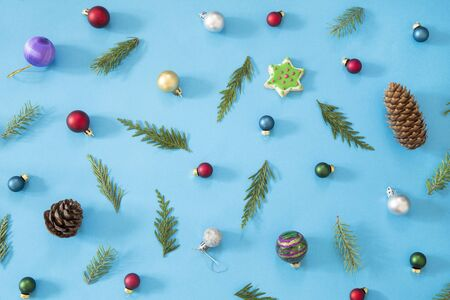 Holiday ornaments on blue background - top view