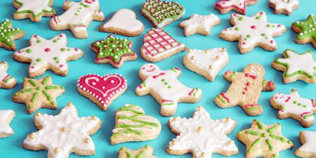 Colorful gingerbread cookies on blue background