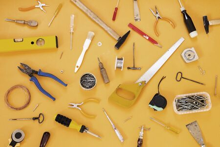 Tools collection on yellow background 写真素材