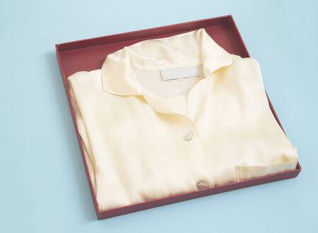Silk sleepwear in a red cardboard box