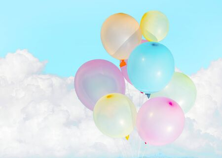Colorful baloons over white clouds Banco de Imagens