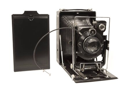 Old camera with a photography panel Archivio Fotografico