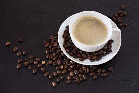 Cup of coffee with the coffee beans