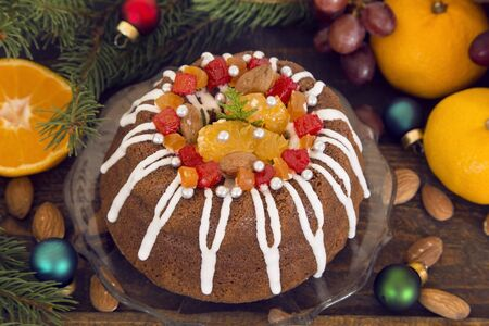 Christmas cake with oranges and colorful ornaments