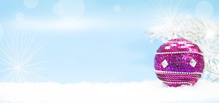 Winter holidays background with apurple bauble