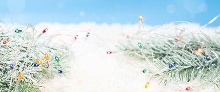Winter holidays background with a light garland Zdjęcie Seryjne