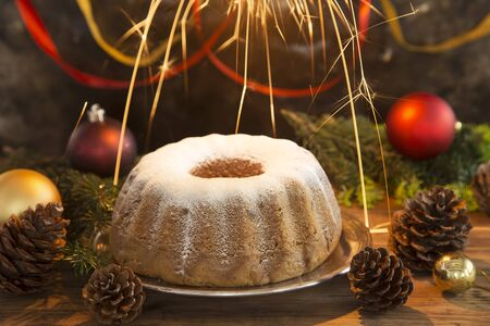 Christmas cake with a burning sparkler