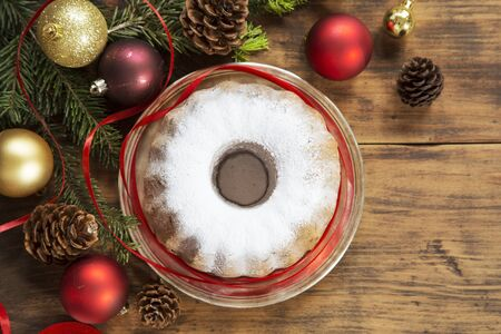 Christmas cake on wooden background with decoration
