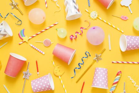 Party accessory on yellow background - top view