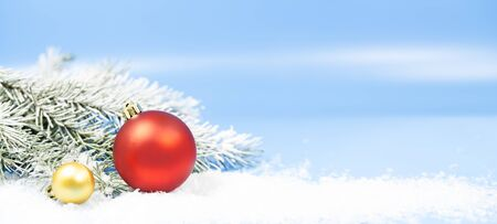 Winter holidays background with decorative baubles