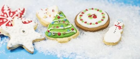Gingerbread cookies on white snow
